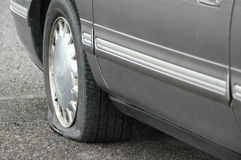 Flat Tire. Car on the road with a flat tire not moving Stock Images