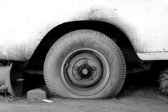 Flat Tire. Broken car with flat tire Royalty Free Stock Photography