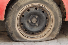 Flat tire. Royalty Free Stock Photography