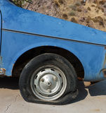 Flat tire of abandoned car Stock Photos