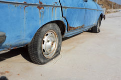 Flat tire of abandoned car Royalty Free Stock Photography