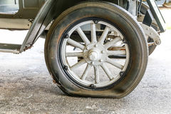 Flat Tire on Antique Car_ Royalty Free Stock Photo