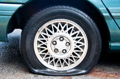 Flat tire on a blue car royalty free stock photography