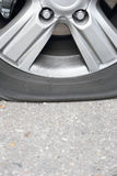 Flat tire car. Vertical image Stock Photography