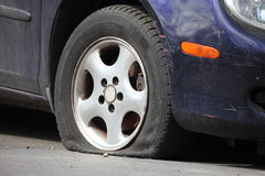 Flat Tire. Of a car Royalty Free Stock Image