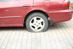 Flat tire on car wheel Stock Image