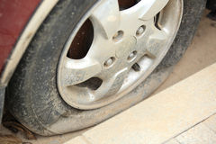 Flat tire on car wheel Royalty Free Stock Image