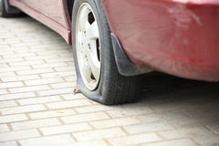 Flat tire on car wheel Stock Photography