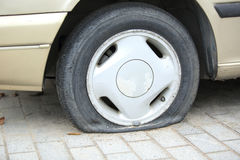 Flat tire on car wheel Royalty Free Stock Photography