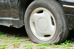 Flat tire on car wheel Stock Images