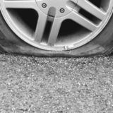 Flat tire closeup detail. Deflated, puncture, punctured, frustrating, frustrated, frustration, bad, luck, problem royalty free stock images