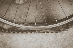 Flat tire on dirt road with sepie tone Stock Photos