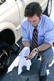 Flat Tire - Dirty Hands Stock Photography