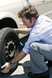 Flat Tire - Dirty Job Stock Photo