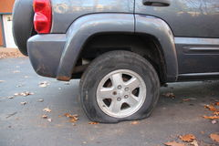 Flat tire. On Jeep Liberty 2004 stock photography