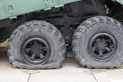 Flat tire of military vehicles Stock Image