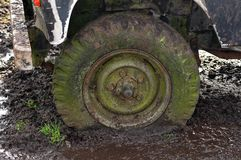 Flat tire in mud. 4x4 Flat tire in mud royalty free stock photos