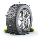Flat tire. With nails on white background - 3D illustration Royalty Free Stock Photos