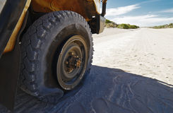Flat Tire On Off-Road Vehicle Stock Image