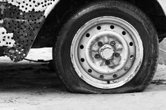 Flat tire of old car Stock Images