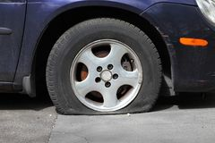 Flat Tire. Of an old car Royalty Free Stock Images