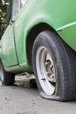 Flat tire of old car Royalty Free Stock Images