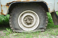 Flat tire on an old rusty SUV close-up. stock photography