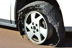 FLAT TIRE - Rim on Asphalt Stock Photos