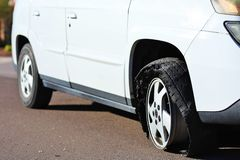 FLAT TIRE - Rim on Asphalt. Closeup of a completely ruined car tire after a flat Stock Photography