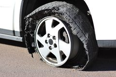 Flat Tire - Rim on Asphalt Stock Images