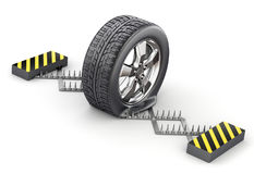 Flat tire on the spike strip Stock Images