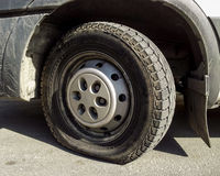 Flat tire Royalty Free Stock Images