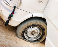 Flat tire of white car Stock Photography