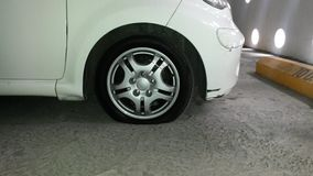 Flat Tire white car Stock Image