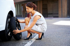 Flat tire woman Royalty Free Stock Photos