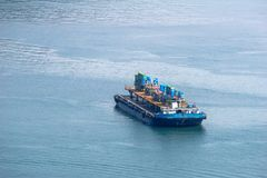 Flat top barge carries structures that seem to be an oil rig royalty free stock photos