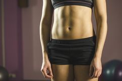 Flat tummy of young female training at fitness club, beautiful healthy fit body. Stock footage stock images