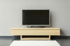 Flat-TV standing on the commode in the room Stock Image
