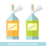 Flat two glass bottles with yelow and green mixture or medication. Stock Photo