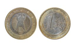 European Union 1 euro. A flat, typically round piece of metal with an official stamp, used as money royalty free stock images