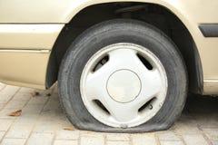 Flat tyre on car wheel. Closeup of flat tyre on car wheel Royalty Free Stock Image