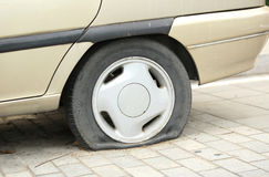 Flat tyre on car wheel Stock Image
