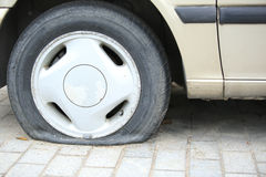 Flat tyre on car wheel Royalty Free Stock Image