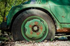 Flat tyre of old track Royalty Free Stock Photo