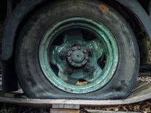 Flat tyre of old truck. Requires replacement. Royalty Free Stock Image