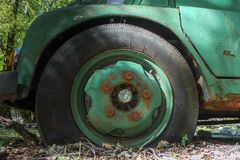 Flat tyre of old truck. Out of energy. Royalty Free Stock Photography