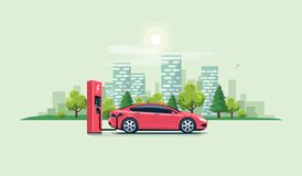 Electric Car Charging at the Charging Station with City Stock Photos