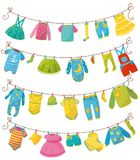 Flat vector set of kids clothes on rope. Apparel for newborn boy or girl. Bodysuit, skirt, t-shirt, sweater, pants, baby. Big collection of kids clothes on rope Royalty Free Stock Photo