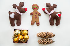 Flat view of cute Christmas decoration and toys. Flat view of cute Christmas decoration, cones, box of glass balls, ginger man, Rudolph the Red Nosed Reindeer Stock Photos