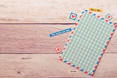 Flat view of empty postcard mock up frame decorate with stickers on wooden beige table royalty free stock photography
